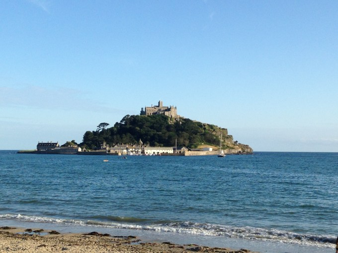 St Michael's Mount with the sea in and a blue sky with no clouds.