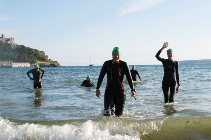 Tamsyn walking out of the sea after St. Michael's Mount Swim.