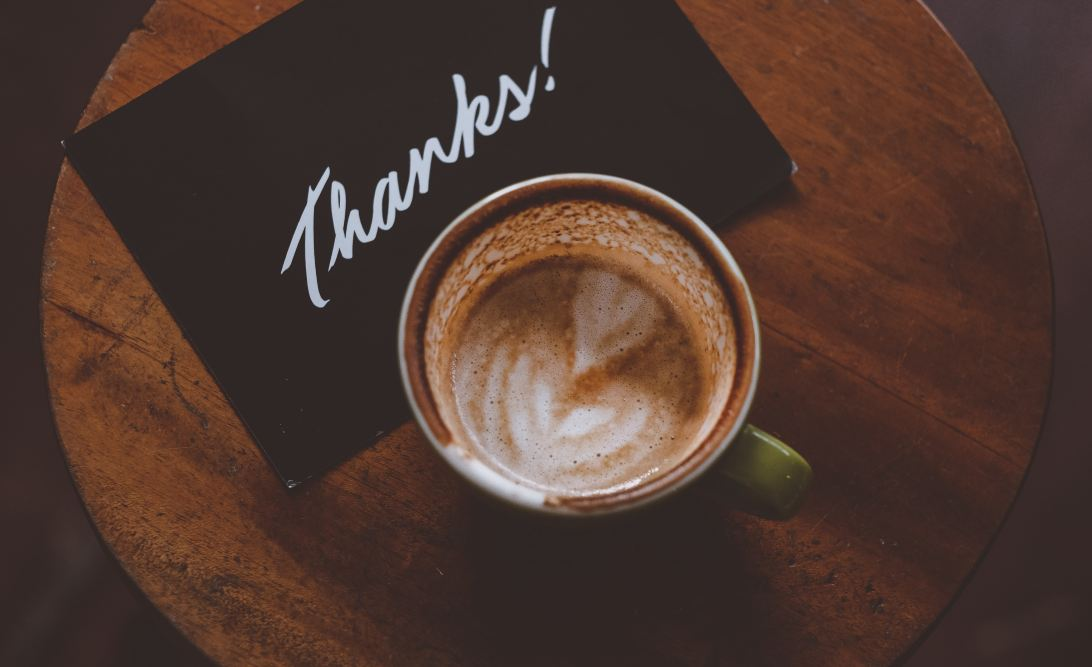 Thank you note and a cup of coffee