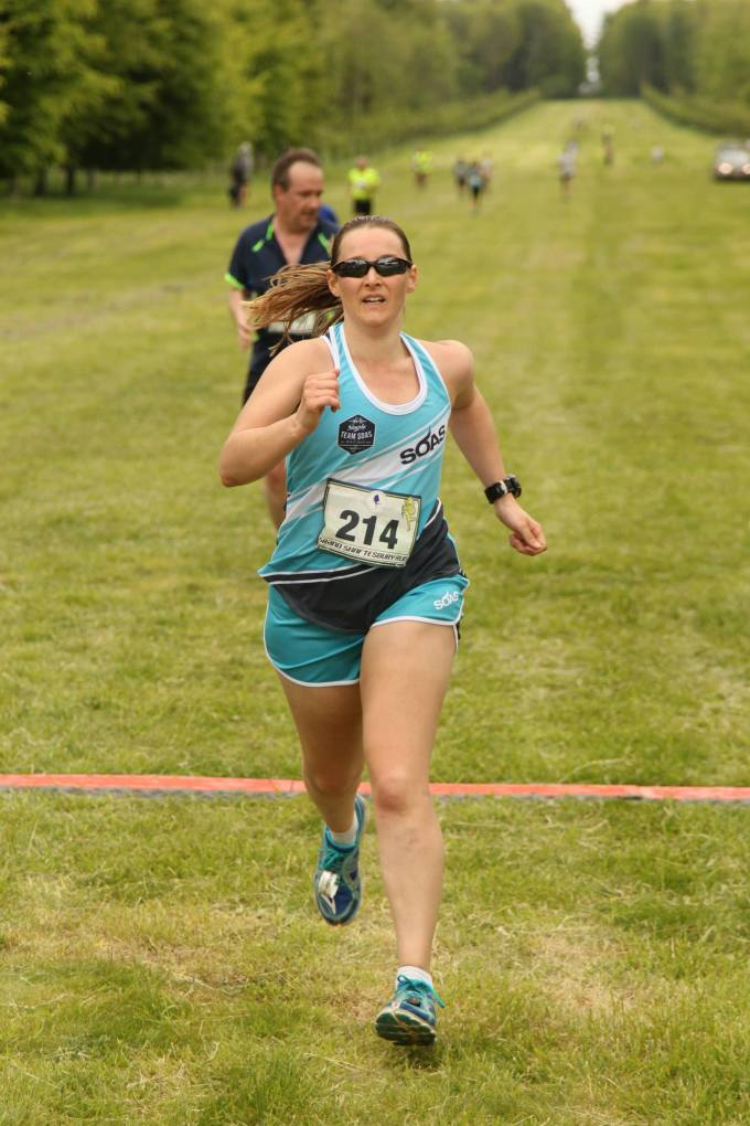 Tamsyn finishing Grand Shaftesbury Run 2015. She is sprinting towards the finish and looks determined.