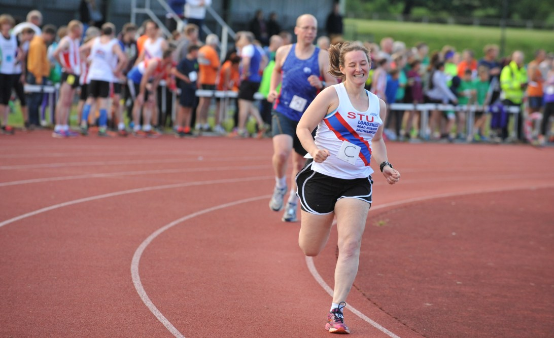 Photo of Tamsyn running a mile on the track ©Paul A. Hammond