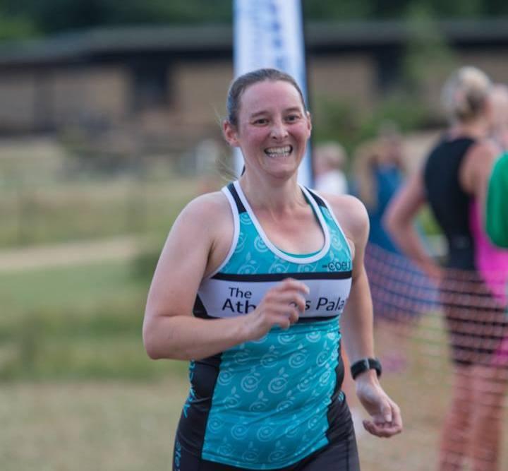 Tamsyn at the finish of HOWL aquathlon