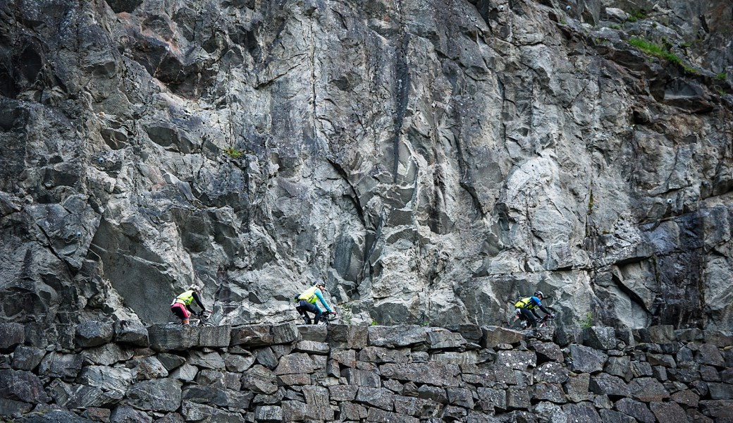 Cyclists against the rocky landscape during Norseman triathlon