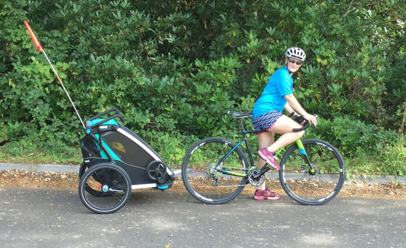 Tamsyn on her bike with the Thule Chariot Cross as a bike trailer