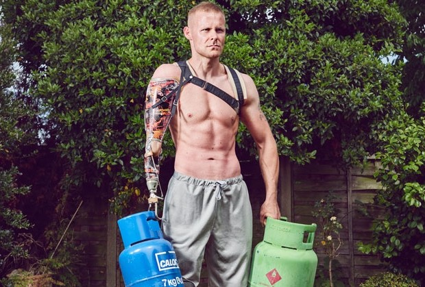 Image of Mark Ormrod lifting two calor gas cans