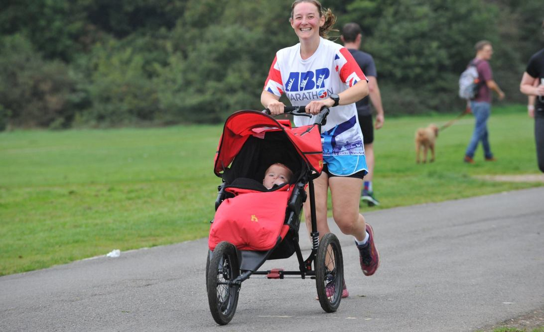 Tamsyn running with M in her buggy at Southampton parkrun on 14th October 2017