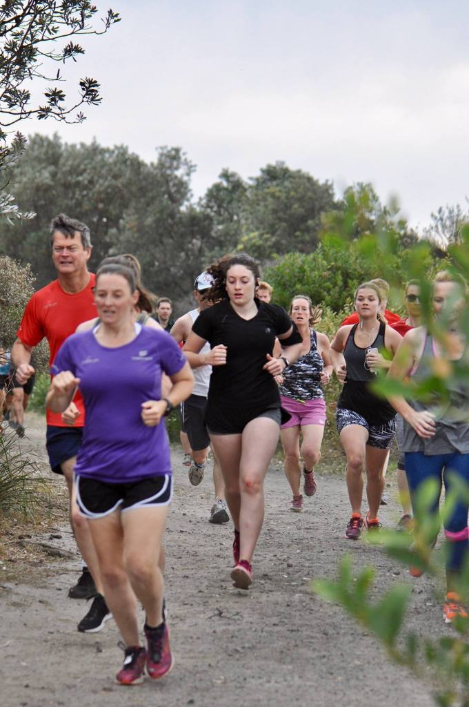 Tamsyn running with others at North Wollongong parkrun.