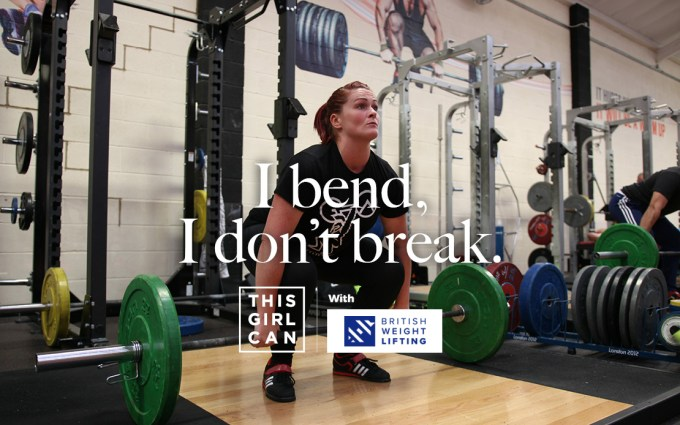 Woman lifting free weights with the slogan 'I bend, I don't break'
