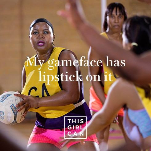 This Girl Can advert showing a woman holding a netball with the slogan 'My gameface has lipstick on it.'