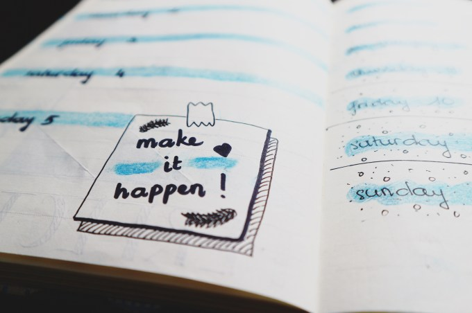 Planner with the words 'Make it happen' and planning notes