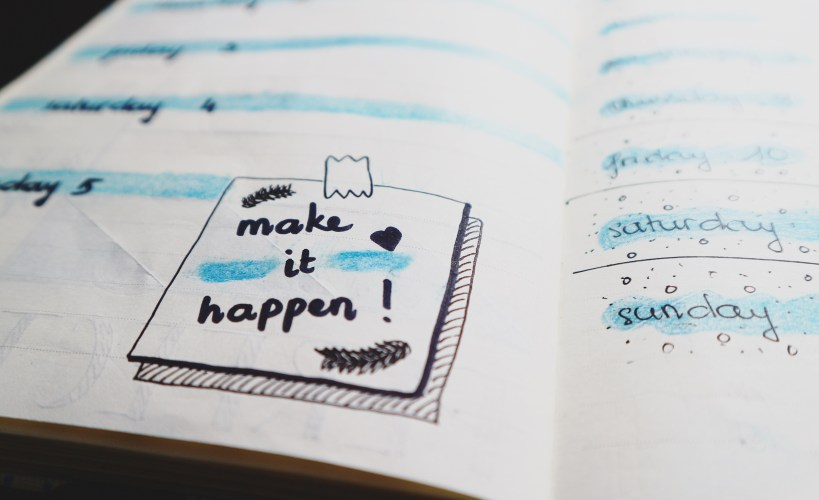 Planner with the words 'Make it happen'