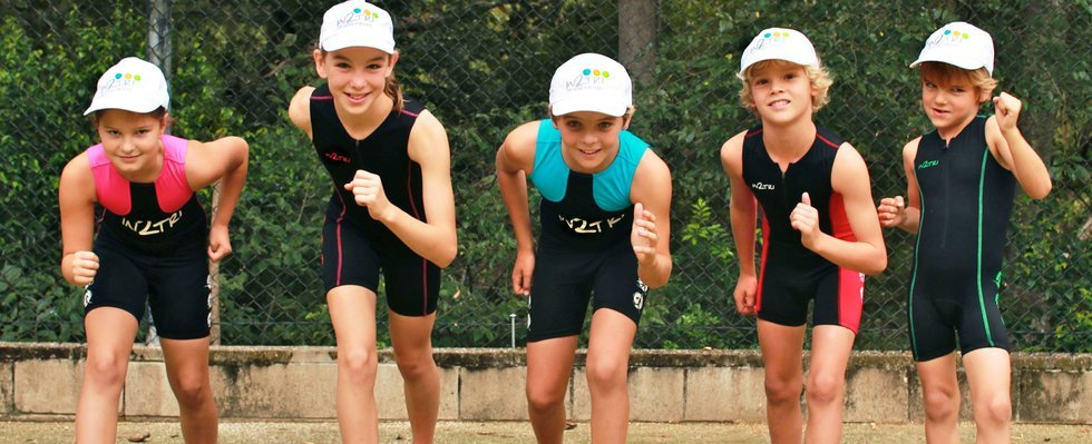 Children modelling children's trisuits
