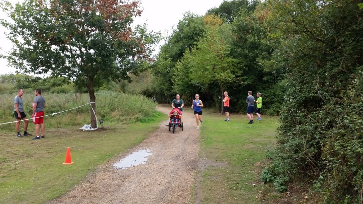 Ellie and Tamyn with M heading towards the finish at Dinton Pastures parkrun