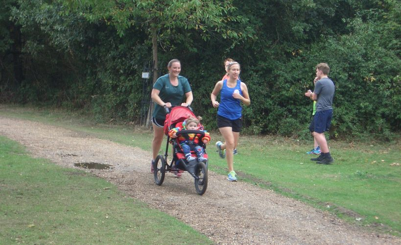 Tamsyn with M and Ellie heading towards the finish of Dinton Pastures parkrun