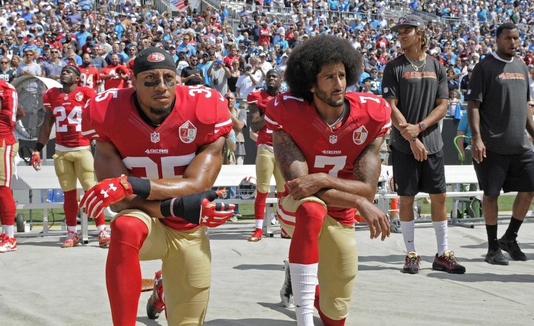 NFL player Colin Kaepernick kneeling to protest against police brutality. Kapernick features in the Nike Dream Crazy advert.