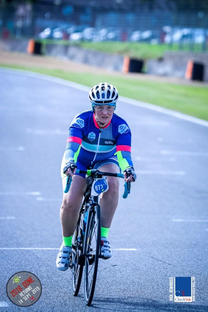 Tamsyn on her bike looking focused