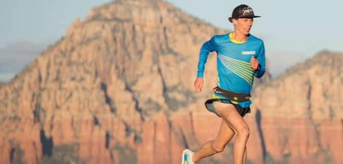 Jim Walmsley running against a backdrop of mountains
