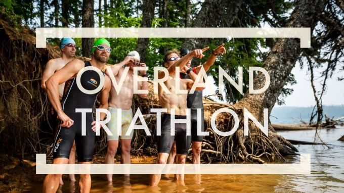 Still image from Overland Triathlon film showing a group of people in trisuits or swimming trunks getting ready to race.