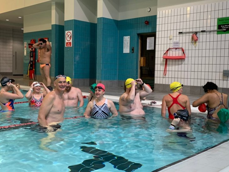 A group of swimmers in a pool.