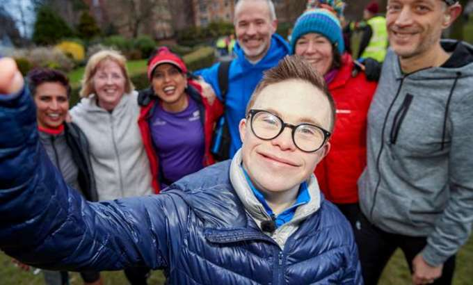 George Webster taking a selfie with a group of his parkrunning friends.