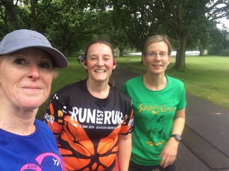 Three women wearing running clothes.