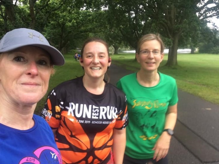 Three women wearing running clothes.
