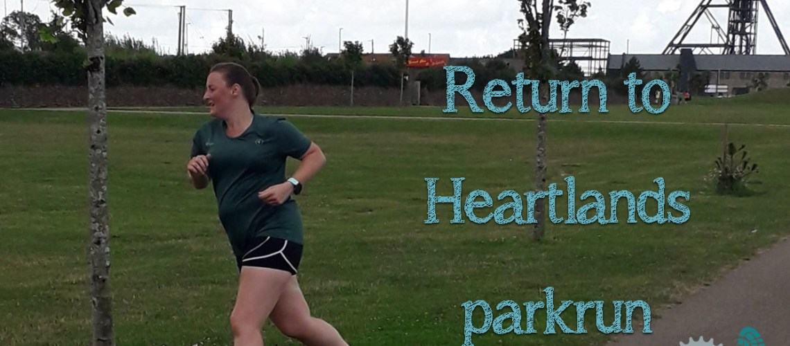 Tamsyn running at Heartlands parkrun. South Crofty mine can be seen in the background.