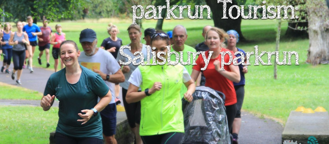 Tamsyn running in a green parkrun t-shirt in focus in the foreground, with other parkrunners behind her.