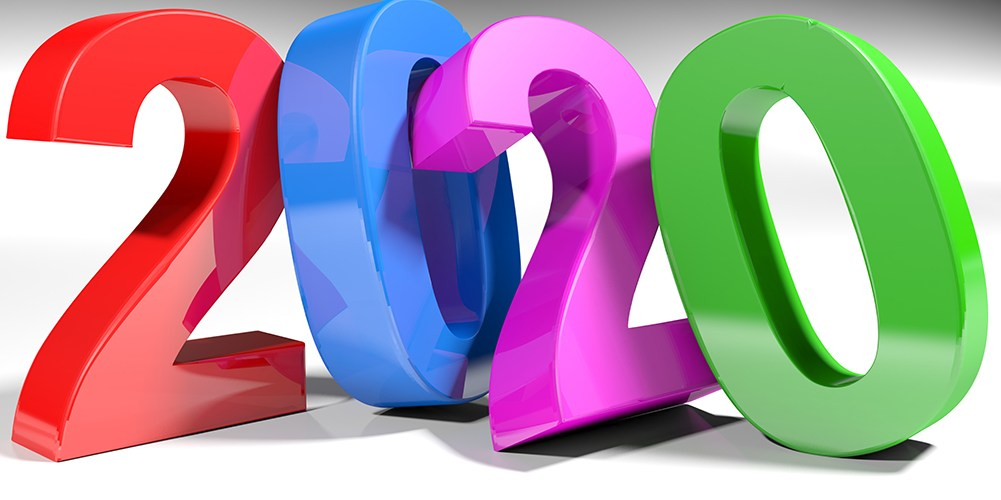 2020 is written with 3D colourful numbers saying 2020 standing on a white surface.