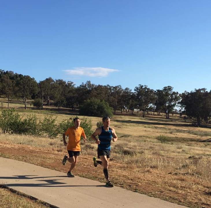Stuart and another runner towards the start of Cowra parkrun.