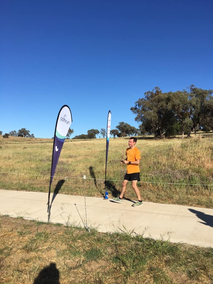 Stuart at the finish of Cowra parkrun.