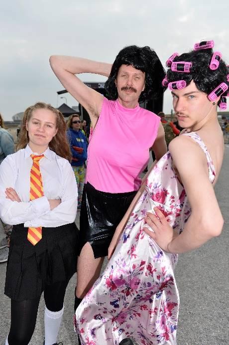 People dressed as Freddie Mercury and a school girl.
