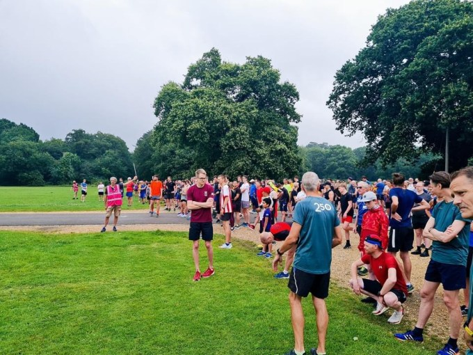 A view of runners across a wide start line on Southampton Common.