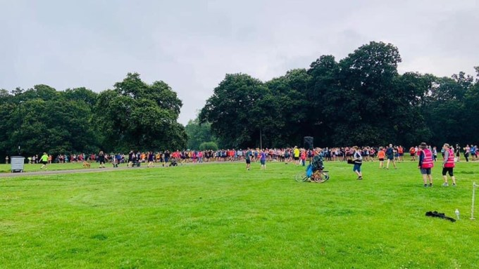 Approx. 500 people gathering at the start of Southampton parkrun. They are spread about 150m wide.