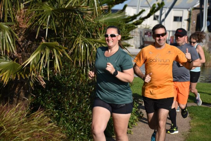 Tamsyn looking determined whilst running. Stu is just over her shoulder.