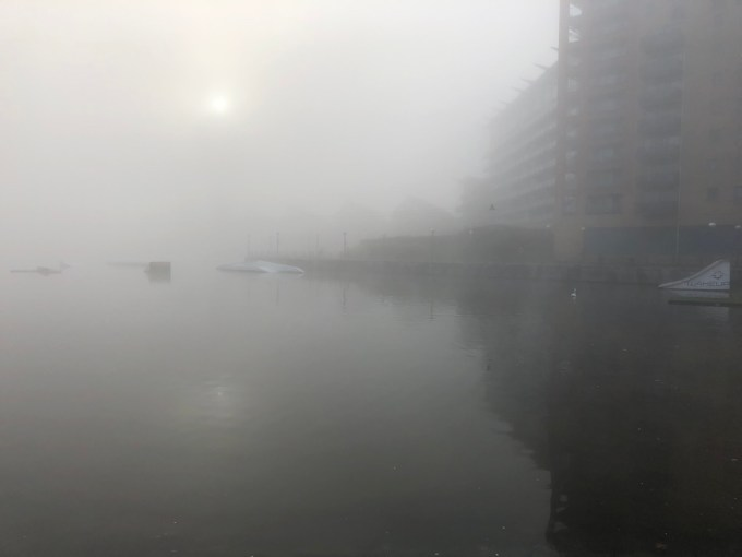 Fog hanging over the Thames.