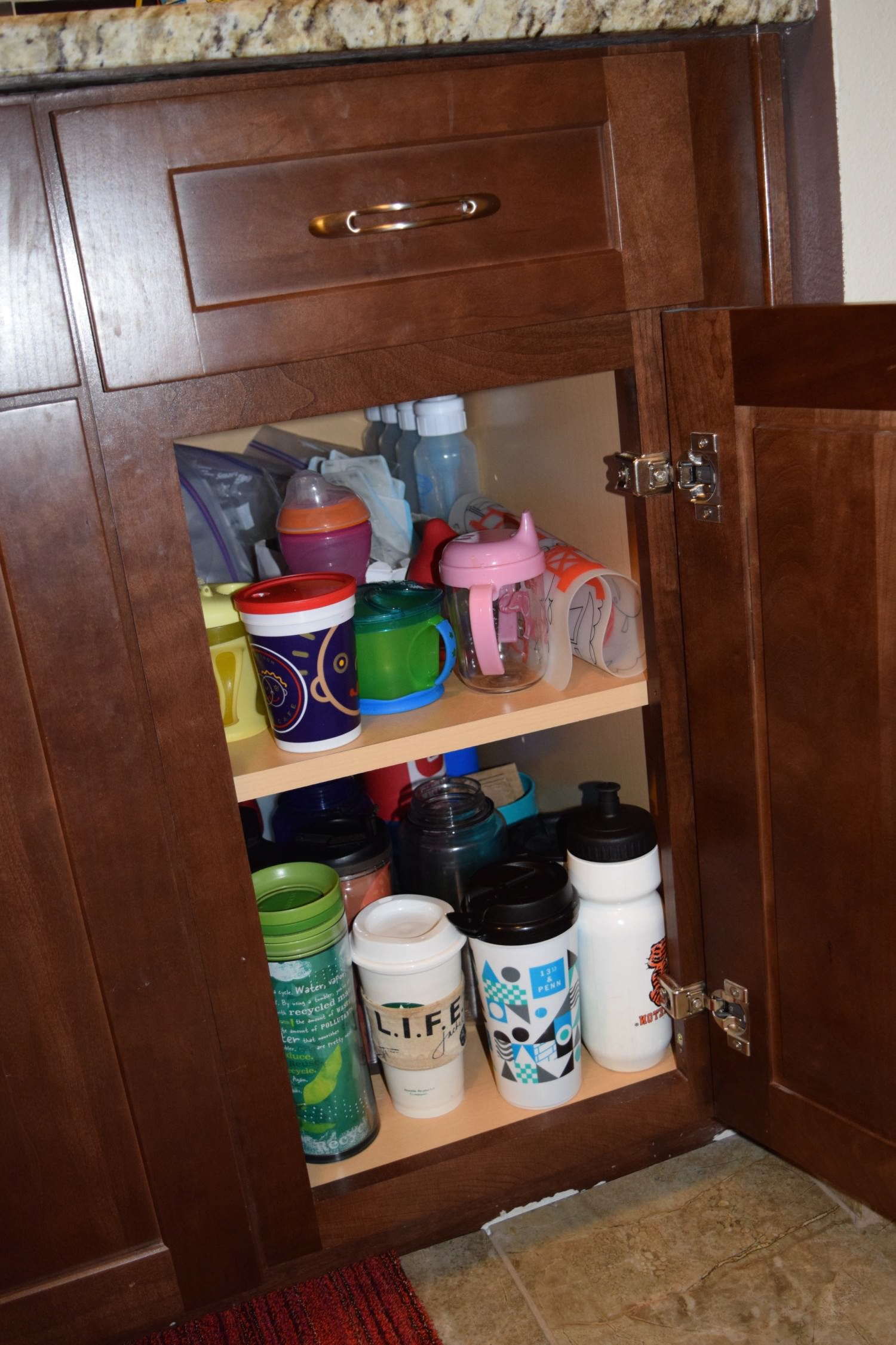 A fully stocked baby/toddler friendly cabinet.