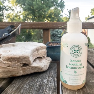 Honest Company Bottom Wash on a wooden table outside