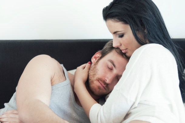 Woman comforts her husband