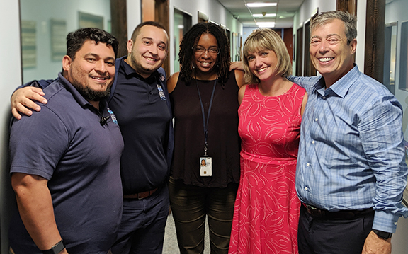 Marine Corps Veteran and Intake Supervisor Dr. Juan Flores, far left, at Operation Sacred Trust with Engagement Director Jacob Torner, VA VISN 8 Network Homeless Coordinator Nikki Barfield, VA SSVF Regional Coordinator Jennifer Colbert, and program co-founder Seth Eisenberg. The group provided more than $4.2 million in emergency funding for very low income Veterans facing homelessness in Miami-Dade and Broward counties.