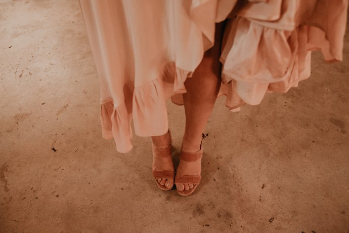 Pink suede bride shoes and pink wedding dress during Pioneertown Soundstage Wedding, photo by Fatima Elreda Photo