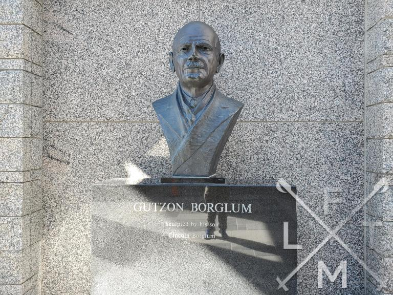 A bronze bust of Gutzon Borglum who was the chief designer of Mount Rushmore.  The pedestal of the statue says that it was sculpted by his son, Lincoln Borglum