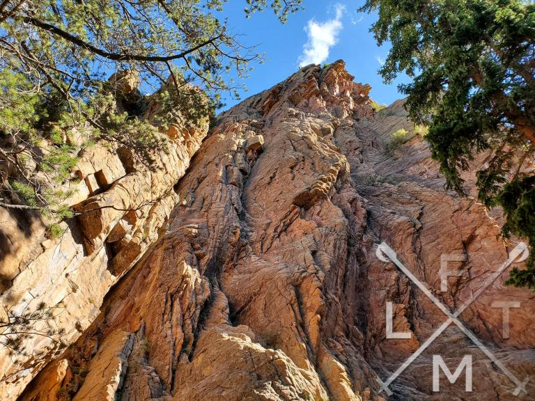 A very large rocky outcrop towers over the mason creek trail