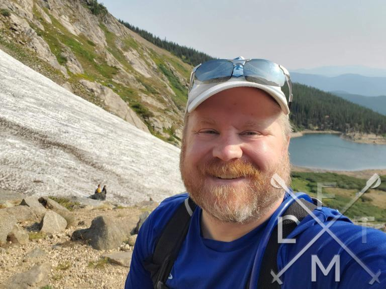 Me with a big smile on my face overlooking St. Mary's Glacier.