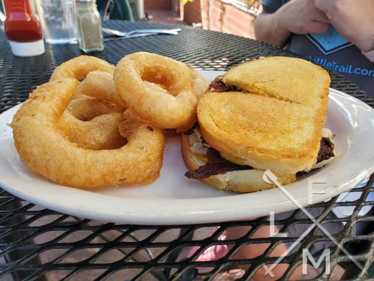 The turkey bacon cheese melt  Served with a side of very large onion rings.