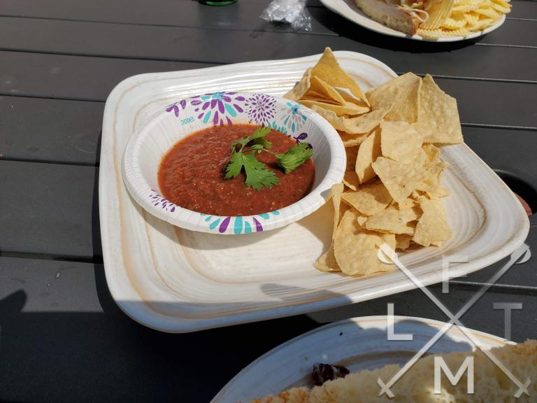 An order of chips and salsa.  The Salsa had what I assumed to be a cilantro leave on the top of it.