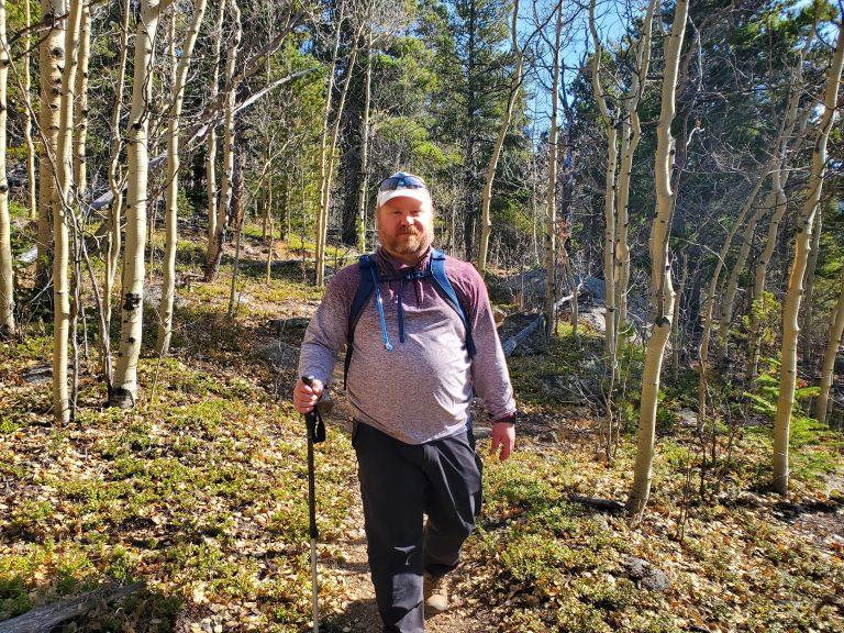 A photo of me walking through an aspen grove  wearing my Kuhl Traverse pants