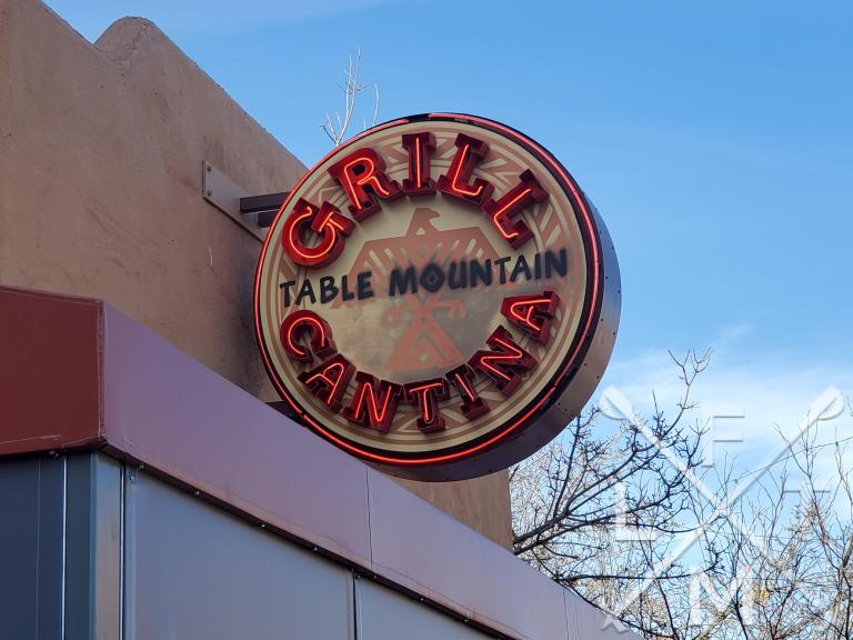 The southwestern style sign for the Table Mountain Grill and Cantina