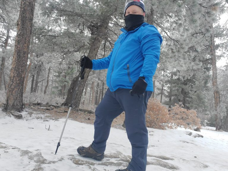My Kuhl Klash pants in Pirate Blue during a hike through a snowy forest.