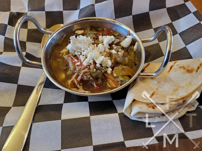 The green chili with a side tortilla from Busey Brews
